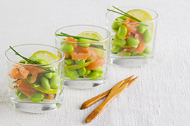 Small glasses with Edamame soybeans, salmon and zucchini