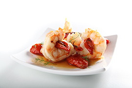 Crayfish tails with caramelized semi-dry cherry tomatoes flavored with thyme