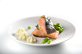 Wild salmon steak flavored with dill with edamame soybeans and mashed potatoes
