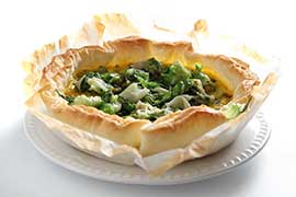 Savory pie with escarole and speck strips