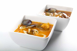 Pumpkin and carrot cream with cuttlefish and large clams