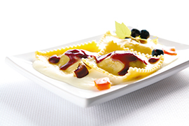 Raviolo with tasty mixed grilled vegetables filling, cream of Colfiorito potato soup and cooked must drops.