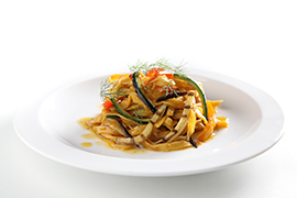 Egg tagliolini with cherry tomatoes of Vesuvius and grilled vegetables in stick