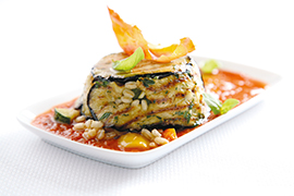 Timbale of aubergine and barley with vegetables, fresh tomato and basil